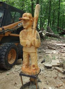 chainsaw sculpture baseball player